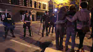 Protesters confront police wearing riot gear Thursday night, a day after Vonderrit D. Myers was shot and killed by an off-duty St. Louis police officer.