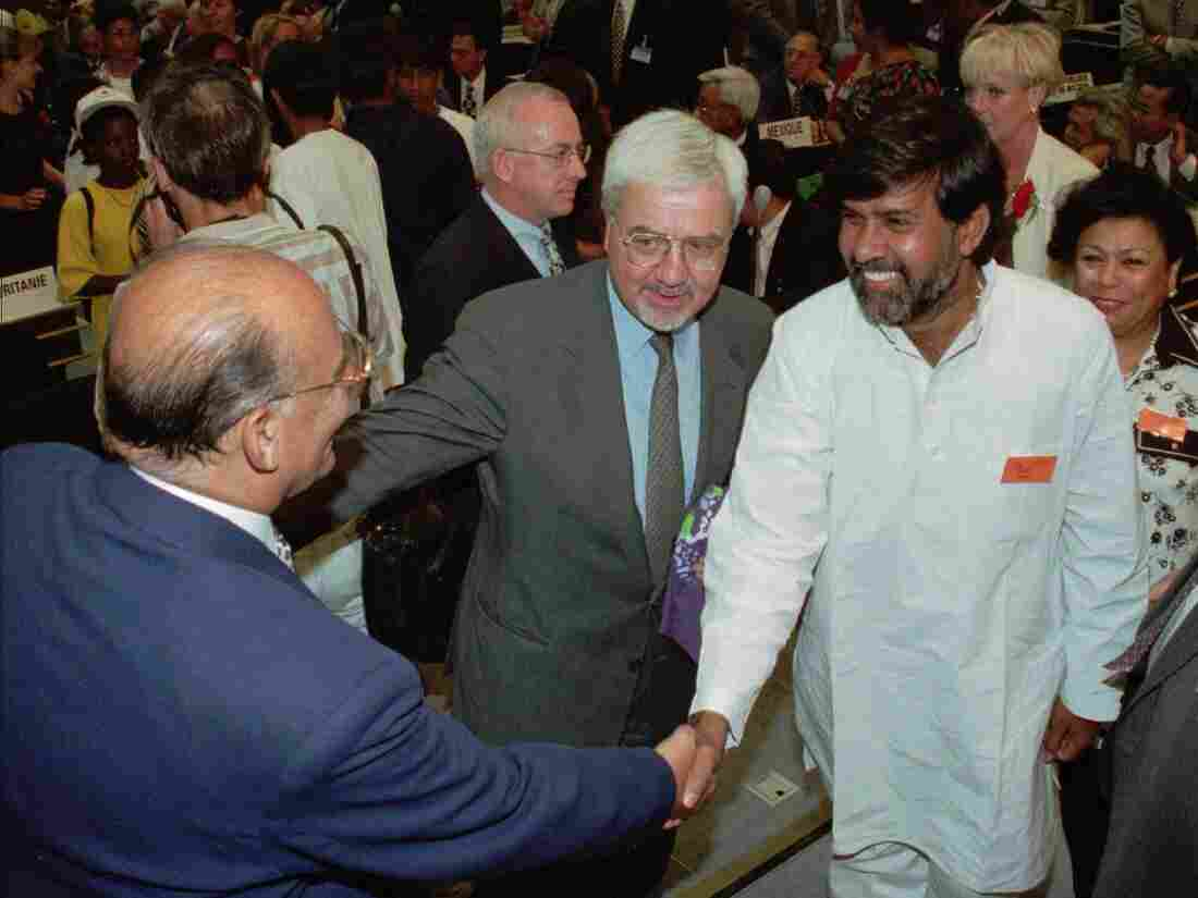 Kailash Satyarthi (in white) greets U.N. officials at a meeting in Geneva in 1998.