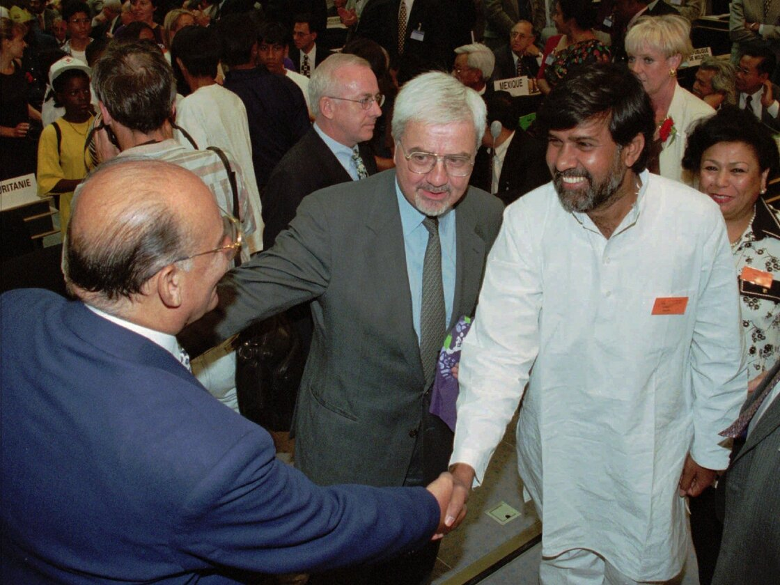 Kailash Satyarthi (in while) greets U.N. officials at a meeting in Geneva in 1998.