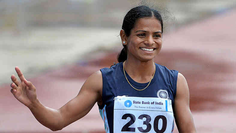 Women's 200 meters respective silver and bronze medal winners from India Dutee Chand, left, and Asha Roy wave to the crowd after their race on the final day of the 2013 Asian Athletics Championship.