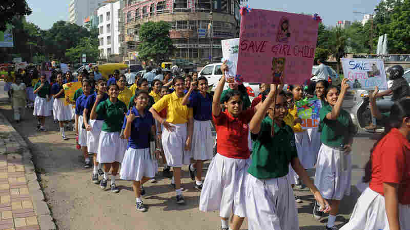 High School students participate in a rally for the International Day of the Girl Child in Ahmedabad, India.