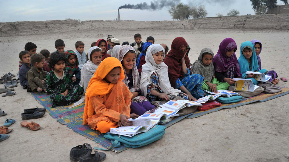 Afghan schoolgirls take lessons outdoors at a refugee camp near Jalalabad. (Noorullah Shirzada/AFP/Getty Images)