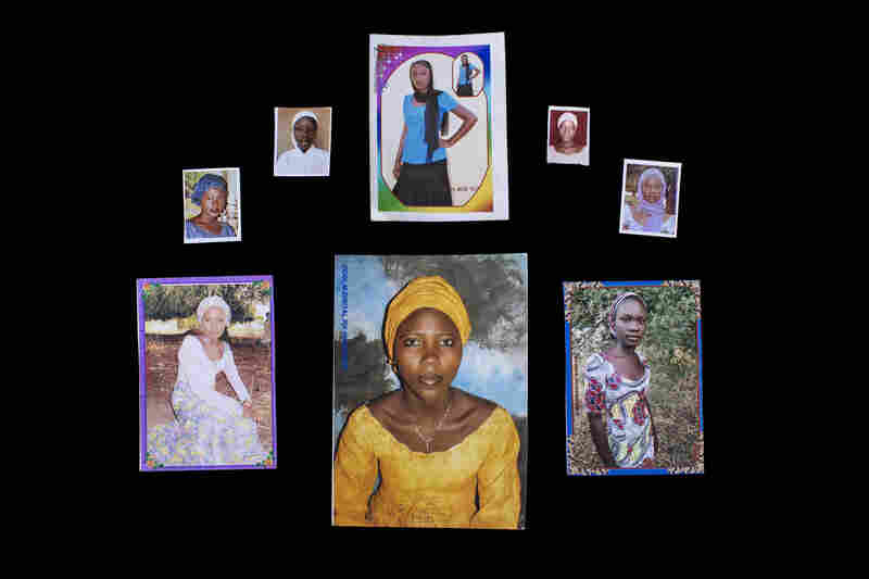 Gordon arranged the photos of some of the kidnapped girls, provided by their families. Top row left to right: Yana Pogu, Rhoda Peters, Saratu Ayuba, Comfort, Bullus, Dorcas Yakubu. Bottom row left to right: Hauwa Mutah, Hajara Isa, Rivkatu Ngalang.'