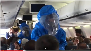 Hazmat team removes passenger from US Airways flight after joke about Ebola.