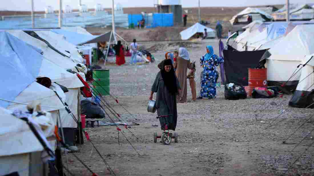 The dirt and gravel at the Baharka displacement camp in northern Iraq will turn to a sea of freezing mud in the winter rain. Aid workers say they don't have enough blankets and winter clothing for all those displaced by the advance of ISIS.