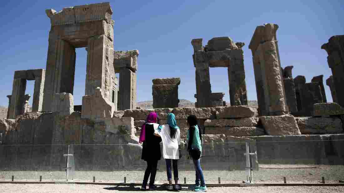 Iranian women look at the palace of King Darius of Achaemenid Persepolis, near Shiraz in southern Iran.