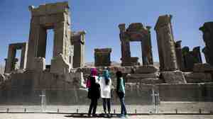 Iranian women look at the palace of King Darius of Achaemenid Persepolis, near Shiraz in southern Iran.