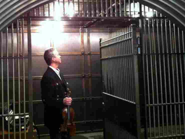 Milwaukee Symphony Orchestra Concertmaster Frank Almond stands inside a vault with his 299-year-old Lipinski Stradivarius. The violin was stolen on Jan. 27 and recovered a week later.