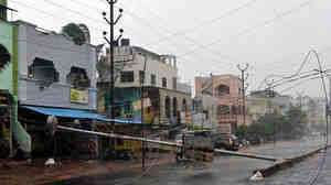 Power cables are seen snapped after the severe cyclone storm Hudhud swept through India's southern city of Visakhapatnam Sunday. Several people died because of the storm, officials say.