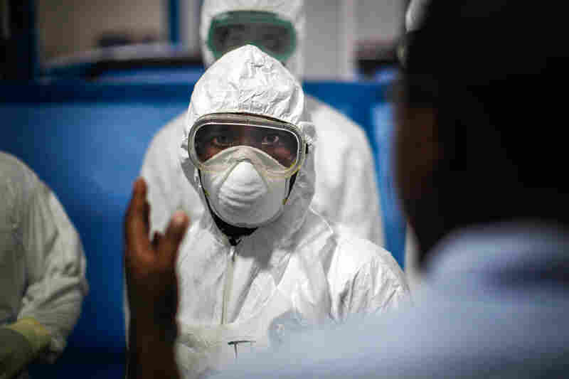 "Trainees suit up on their fifth and final day of training and their first ""dress rehearsal"" before being sent out to Ebola treatment units."