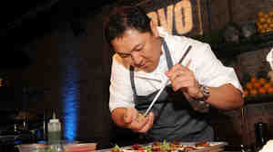 Chef Sang Yoon prepares a dish at the Top Chef Masters Season 5 Premiere Tasting Event. The rise of competition cooking shows has quickly overtaken the traditional, how-to style of cooking television.