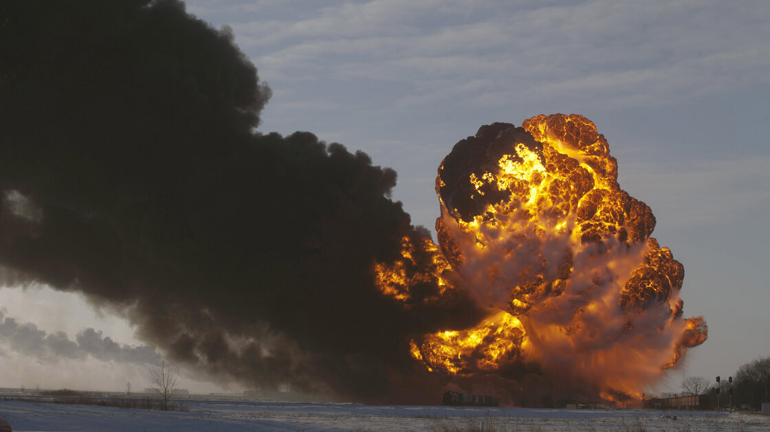 A fireball goes up at the site of an oil train derailment in Casselton, N.D., in this Dec. 30 photo. The fiery crash left an ominous cloud over the town and led some residents to evacuate. - Bruce Crummy/AP