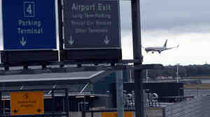 A plane arrives at New York's John F. Kennedy International Airport. Since Ebola screenings began Saturday, none of the 91 passengers identified as having an increased risk of an Ebola infection was found to be sick, the CDC says.