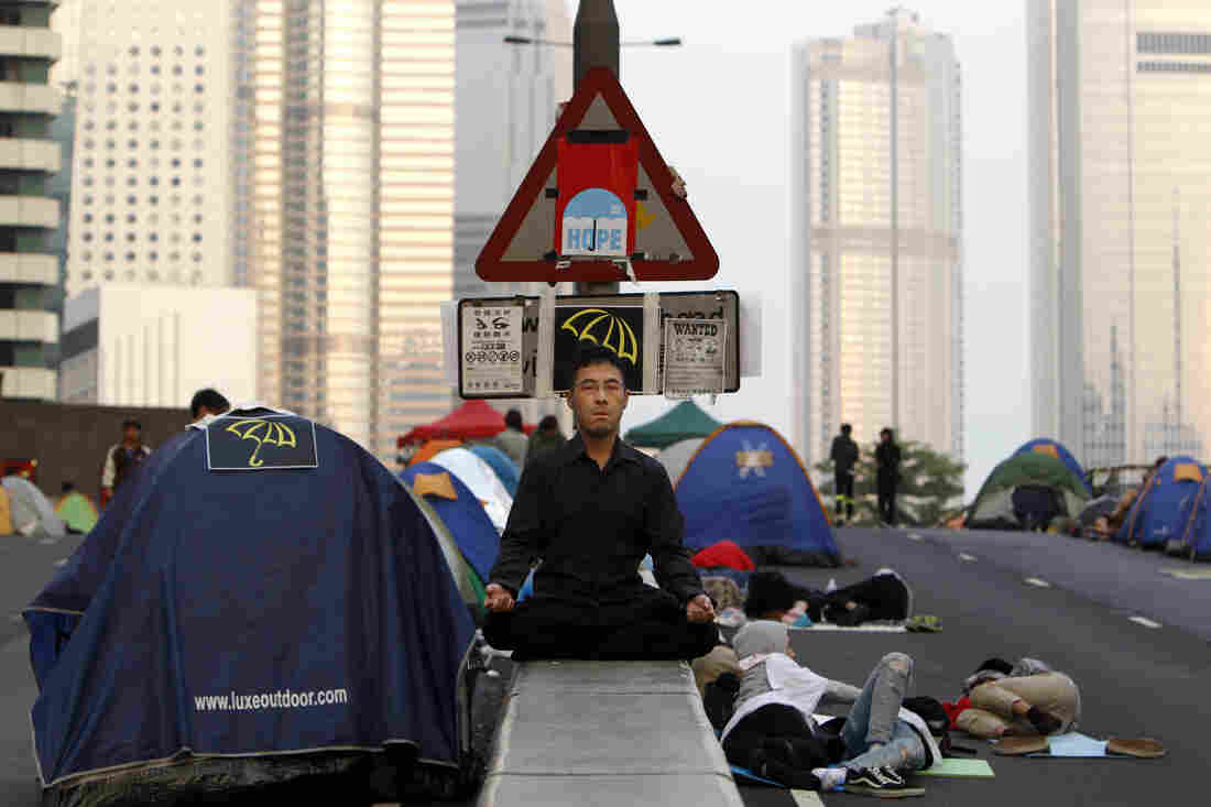 A pro-democracy protester meditates on an occupied bridge leading to the financial Central district in Hong Kong on Tuesday.