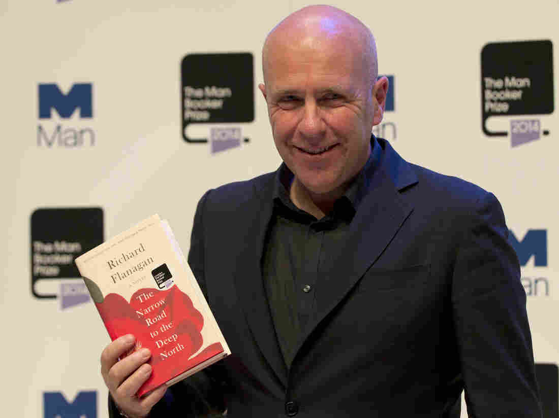 Australian author Richard Flanagan, 2014's Man Booker Prize winner, holds his book The Narrow Road to the Deep North at the Royal Festival Hall in London on Monday.