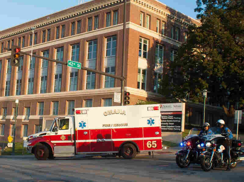 An ambulance transports Ashoka Mukpo, who contracted Ebola while working in Liberia, to the Nebraska Medical Center's specialized isolation unit on Oct. 6, 2014, in Omaha, Neb., where he will be treated for the deadly disease.