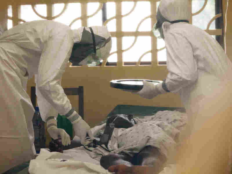 Dr. Kent Brantly, left, treats an Ebola patient at the Samaritan's Purse Ebola Case Management Center in Monrovia, Liberia. On Saturday, July 26, 2014, the North Carolina-based aid organization said Brantly tested positive for the disease and was being treated at a hospital in Monrovia.