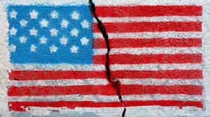 American flag painted on a cracked wall.