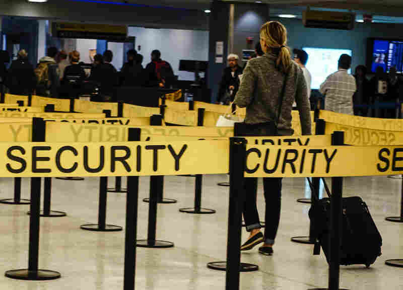 Passengers make their way in a security checkpoint at the International JFK airport in New York on Oct. 11, 2014. Medical teams at New York's JFK airport, armed with Ebola questionnaires and temperature guns, began screening travelers from three West African countries on Saturday as U.S. health authorities stepped up efforts to stop the spread of the virus.