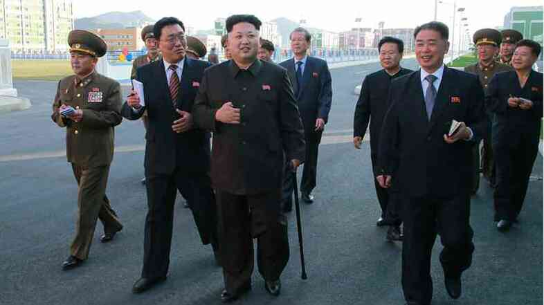 A photo released Monday by the Rodong Sinmun, newspaper of the ruling Workers' Party, shows North Korean leader Kim Jong Un walking with a cane as he visits a residential area in Pyongyang.