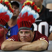 Washington fans watch their team during the second half of an NFL football game against Arizona on Sunday.