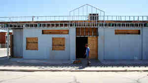 A man walks Oct. 3 past the former site of an El Paso, Texas, clinic that offered abortions. It was one of more than a dozen clinics that closed following the implementation of restrictive new building codes.
