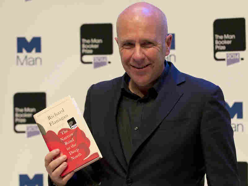 Australian author Richard Flanagan holds his book The Narrow Road to the Deep North, at the Royal Festival Hall in London on Monday.