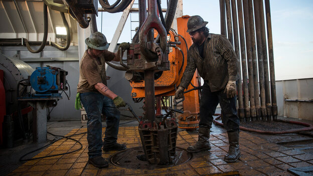 Workers drill for oil in the Bakken shale formation outside Watford City, N.D., an area experiencing an oil boom.