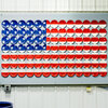 An American flag made of plates is on display at the Homer Laughlin China Co. in Newell, W. Va.
