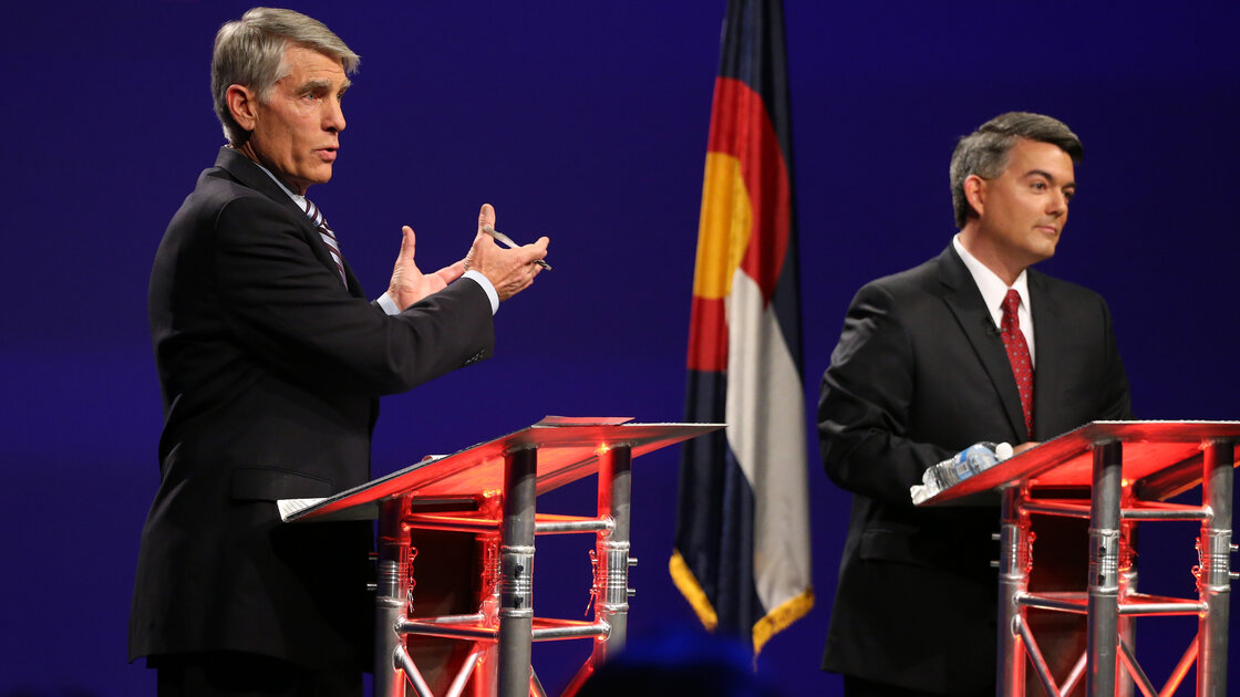 Ebola is the latest issue to spill into debates this season. U.S. Sen. Mark Udall (left) has blamed Republicans for cutting government health resources. His opponent, U.S. Rep. Cory Gardner, says the CDC has been spending wastefully.