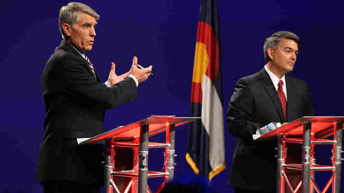 Ebola is the latest issue to spill into debates this season. Colorado Sen. Mark Udall (left) has blamed Republicans for cutting government health resources. His opponent, Rep. Cory Gardner, says the CDC has been spending wastefully.
