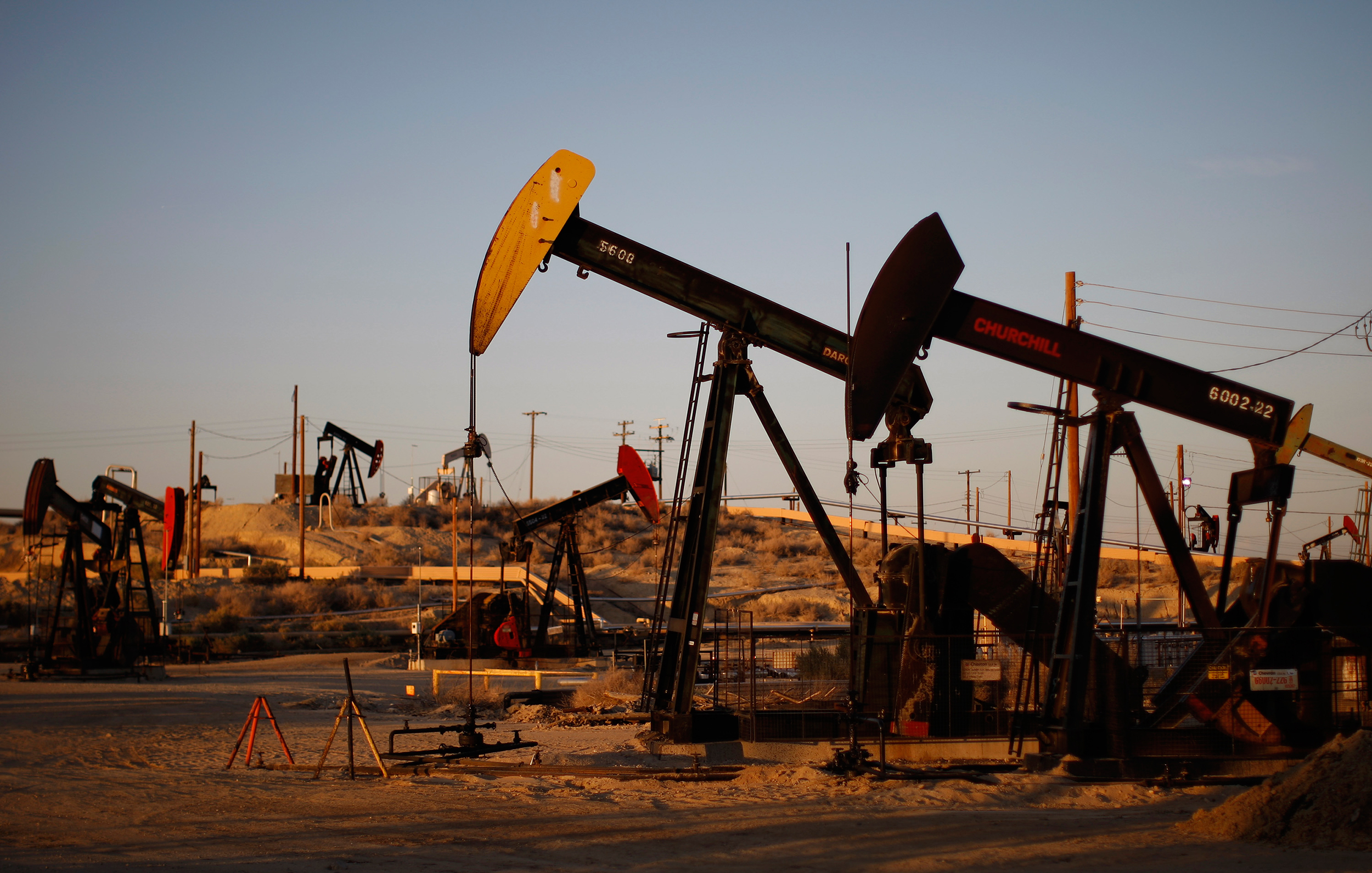 As Oil Prices Fall, Who Wins And Who Loses?