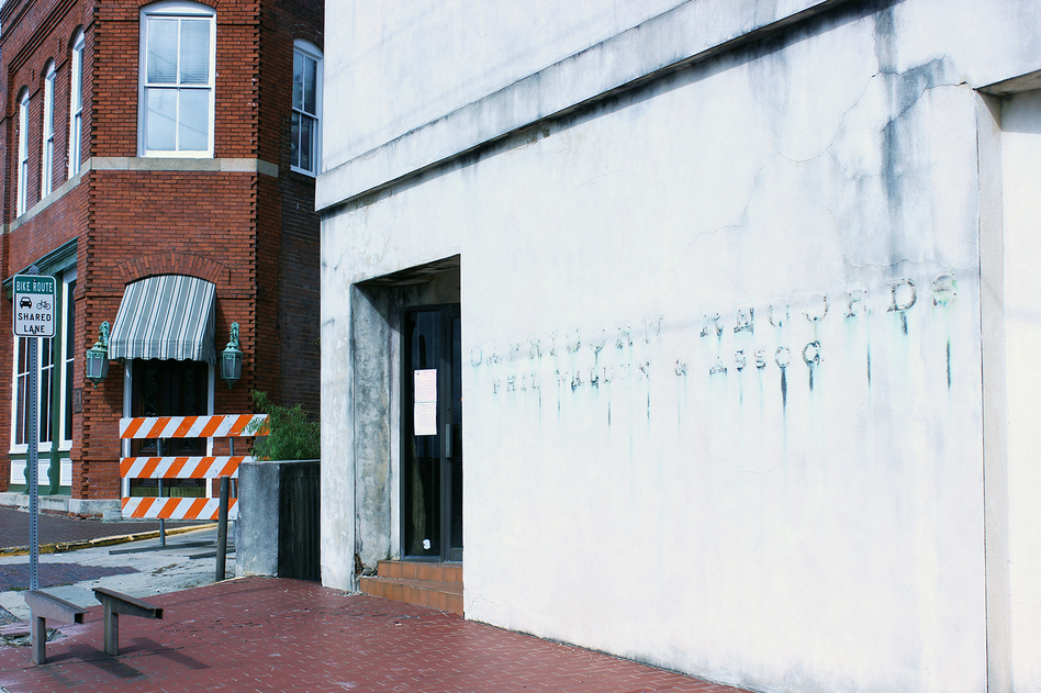 A condemnation notice hangs on the door of the old Capricorn Records office building on Cotton Avenue. The lettering has been removed from the façade in case the building collapses. (Courtesy of Adam Ragusea)