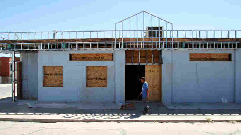 A man walks past the former site of a clinic that offered abortions in El Paso, Texas.