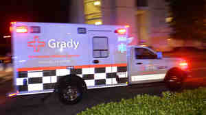 An ambulance carrying Amber Vinson, the second health care worker to be diagnosed with Ebola in Texas, arrives at Emory University Hospital in Atlanta on Wednesday.