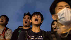 Pro-democracy protesters shout slogans during a standoff with police outside the central government offices in the Admiralty district of Hong Kong on Wednesday.