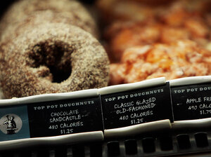 Calories are listed next to menu items in a Starbucks coffee shop in 2008 in New York City.