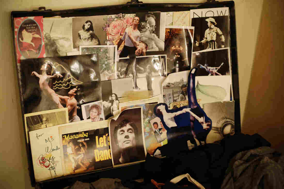 A collage in Whelan's theater case includes a portrait of her husband (bottom center) and a photo given to her by choreographer Christopher Wheeldon with a hand-drawn angel and devil motif.