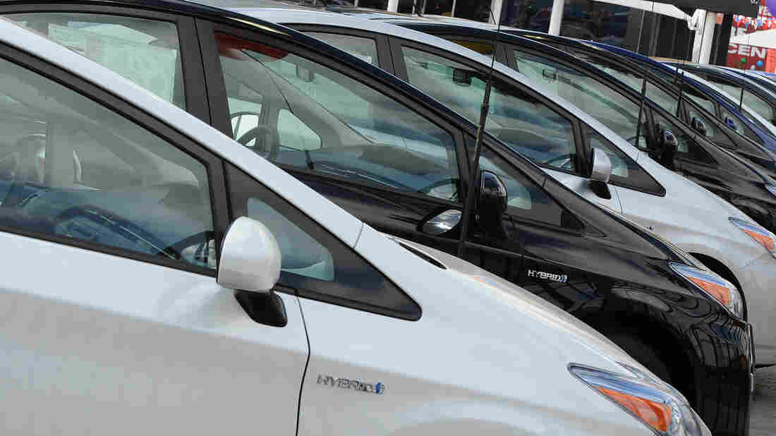 Sales of traditional hybrids, plug-ins and all-electric cars are down about 5 percent in 2014 — while truck and SUV sales have jumped.