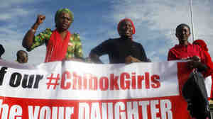 """""""Bring Back Our Girls"""" campaigners march during a rally calling for the release of the Abuja schoolgirls who were abducted by Boko Haram militants in Borno state in August."""