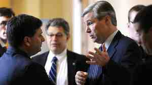 Ron Klain (left), then chief of staff for Vice President Joe Biden, talks with Sen. Sheldon Whitehouse on Capitol Hill in December 2009.
