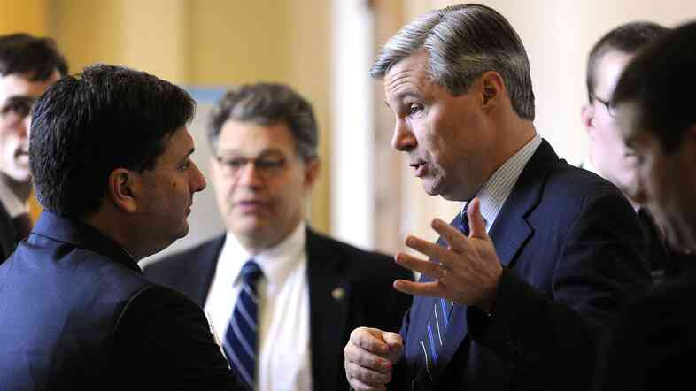 Ron Klain (left), then chief of staff for Vice President Joe Biden, talks with Sen. Sheldon Whitehouse on Capitol Hill in December 2009.