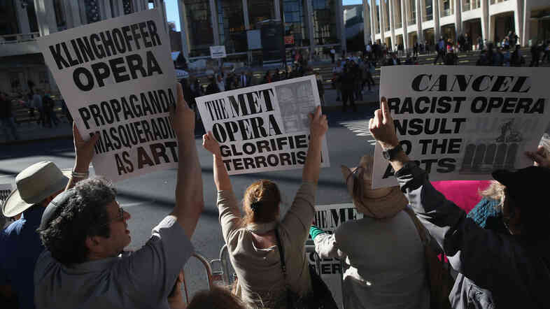 """Several hundred protesters picket the opening night of the Metropolitan Opera season at Lincoln Center, Sept. 22, 2014. """"You will be made to destroy that set,"""" Jeffrey Wiesenfeld said."""