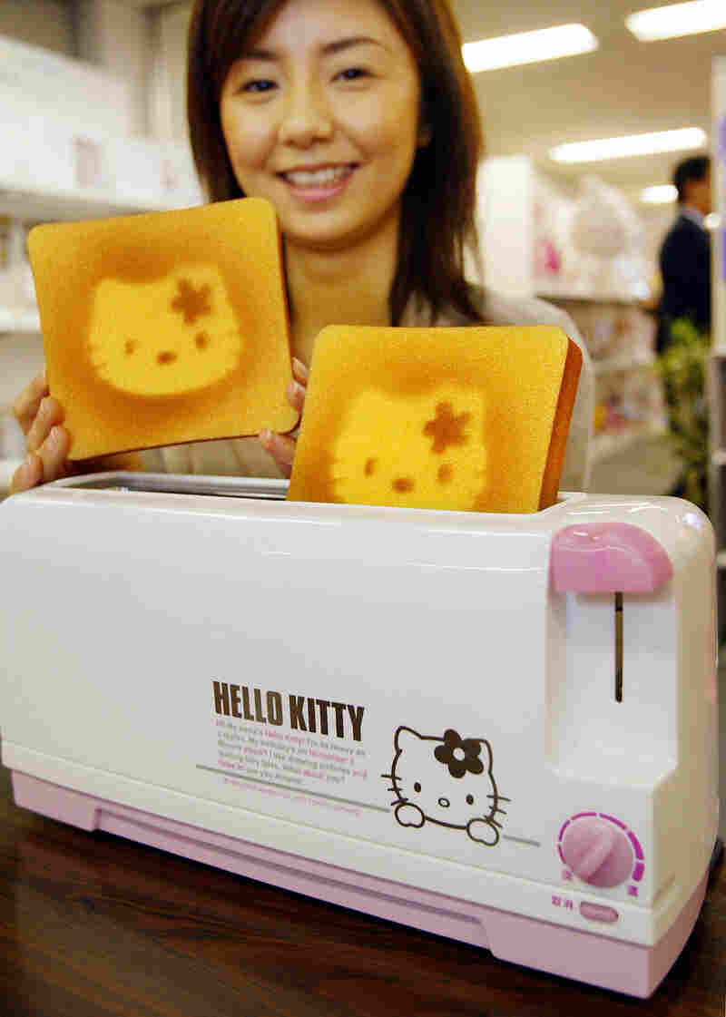 A Sanrio employee displays a Hello Kitty designed toaster celebrating Hello Kitty's 30th birthday in 2004.