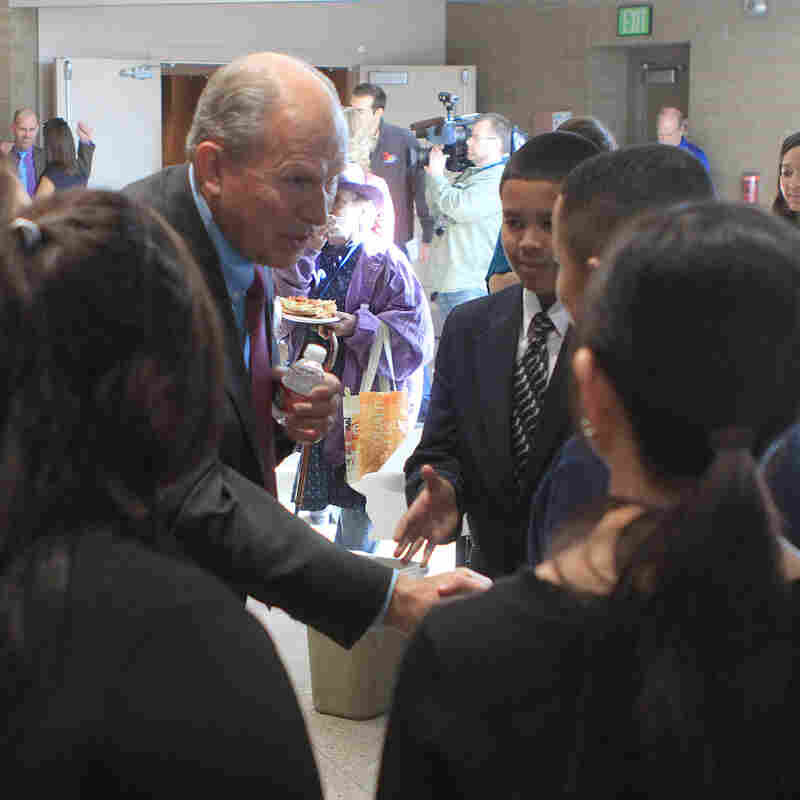 Independent gubernatorial candidate Bill Walker greets Anchorage middle school students before a candidates forum in April. Walker used to be a registered Republican, but now he says he wants to move past party labels.