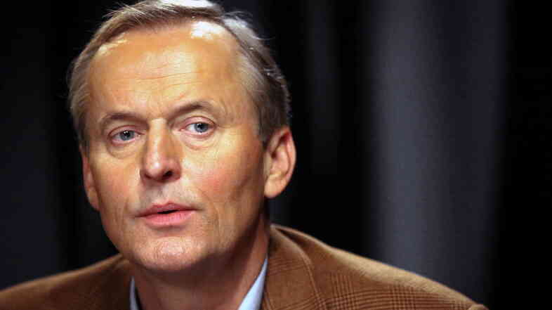 "John Grisham, seen here in 2009, said Thursday in a statement: ""I regret having made these comments, and apologize to all."""