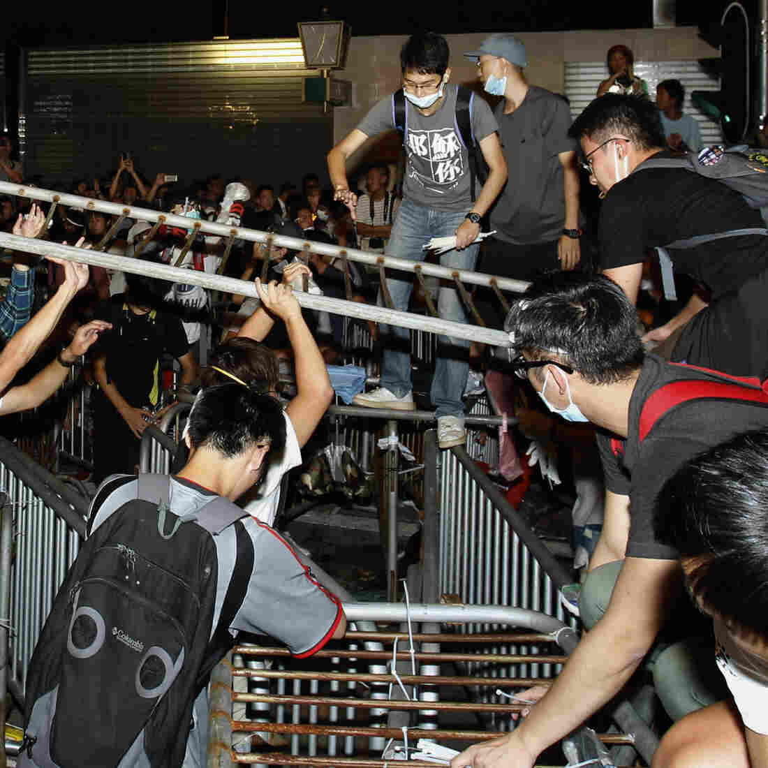 Hong Kong Activists Clash With Police, Retake Protest Site