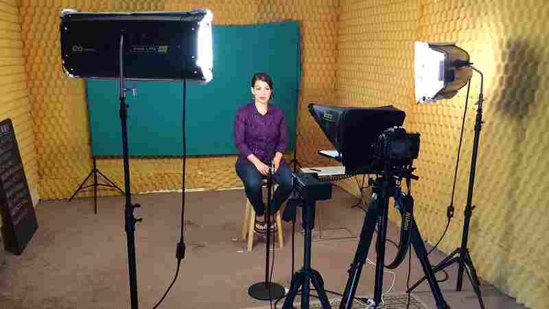 Feminist critic Anita Sarkeesian, seen here filming her Tropes vs. Women web series, recently canceled a talk at Utah State University after the school received threats of a mass shooting at the event.