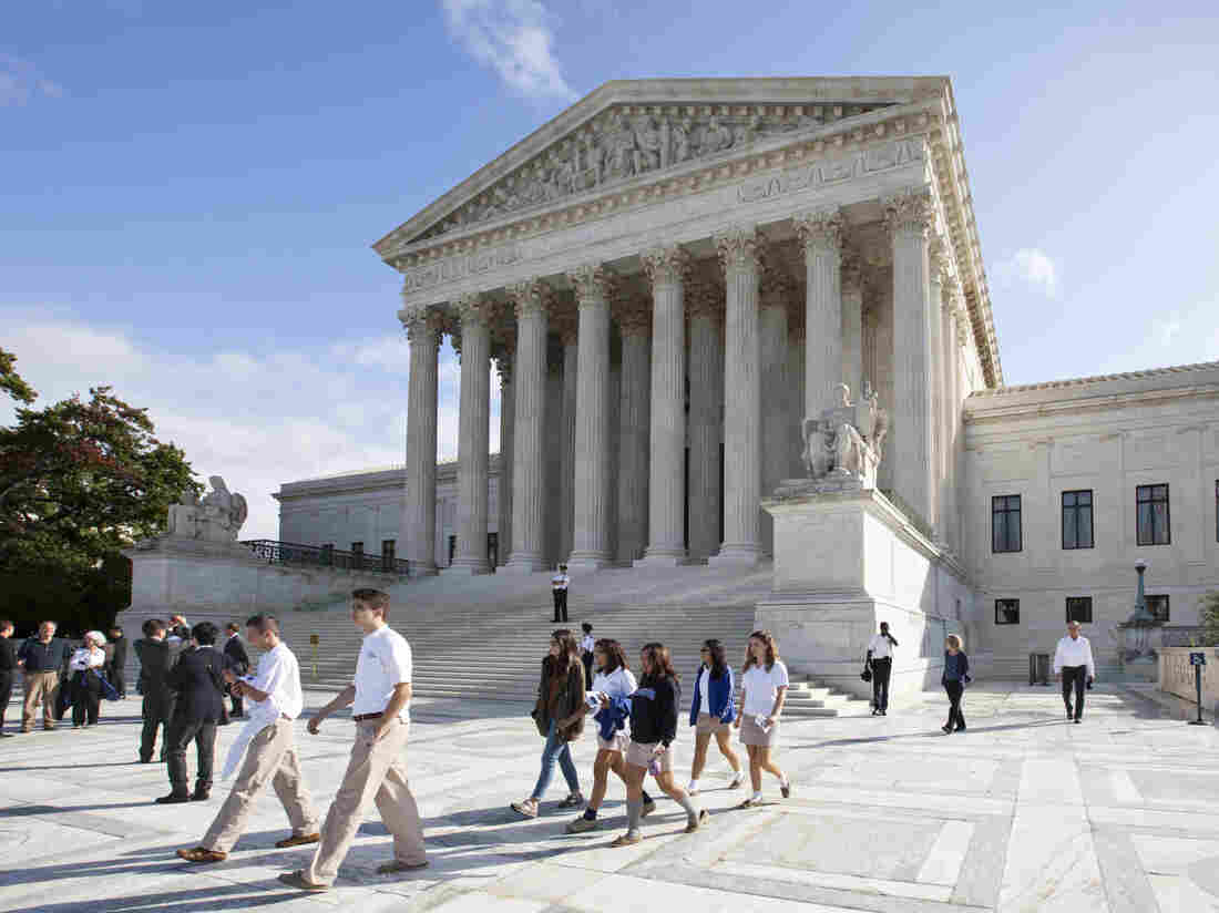 The Supreme Court early Saturday declined to block a Texas Voter ID law for the November election.