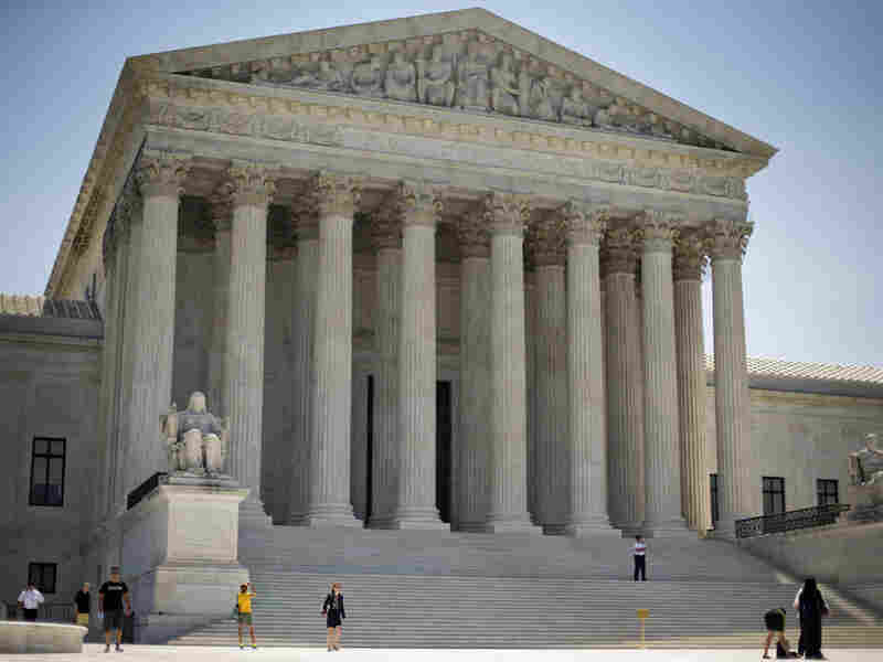The Supreme Court rejected a Justice Department request to block Texas' controversial voter ID law.